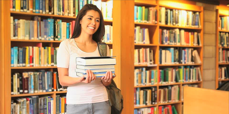 Student smiling in library